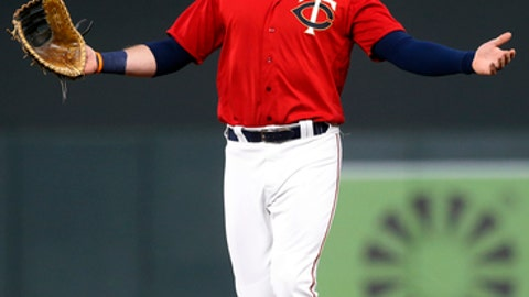 Minnesota Twins first baseman Logan Morrison looks for the shallow pop-up off the bat of Milwaukee Brewers' Jonathan Villar in the sixth inning of a baseball game Friday, May 18, 2018, in Minneapolis. Twins shortstop Ehire Adrianza made the catch. (AP Photo/Jim Mone)