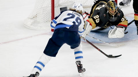 Vegas Golden Knights goaltender Marc-Andre Fleury blocks a shot by Winnipeg Jets right wing Patrik Laine during the second period of Game 4 of the NHL hockey Western Conference finals Friday, May 18, 2018, in Las Vegas. (AP Photo/Marc Sanchez)