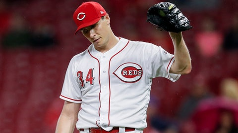 Cincinnati Reds starting pitcher Homer Bailey reacts after walking Chicago Cubs' Ben Zobrist during the fifth inning of a baseball game Friday, May 18, 2018, in Cincinnati. (AP Photo/John Minchillo)