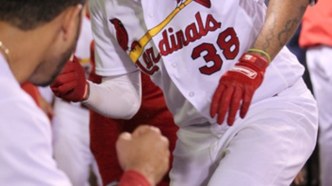 St. Louis Cardinals' Jose Martinez (38) celebrates with teammates after hitting a two-run home run in the sixth inning of a baseball game against the Philadelphia Phillies, Friday, May 18, 2018, in St. Louis. The Cardinals defeated the Phillies 12-4. (AP Photo/Tom Gannam)