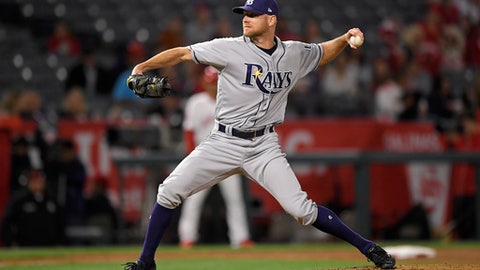 Tampa Bay Rays relief pitcher Jonny Venters throws to the plate during the ninth inning of a baseball game against the Los Angeles Angels Friday, May 18, 2018, in Anaheim, Calif. (AP Photo/Mark J. Terrill)