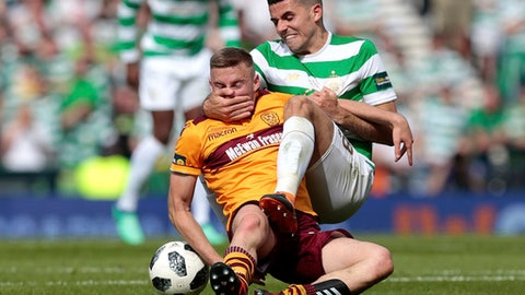 Celtic's Tom Rogic, right, vies with Motherwell's Allan Campbell during the Scottish Cup soccer final match, at Hampden Park, Glasgow, Scotland, Saturday, May 19, 2018. (Graham Stuart/PA via AP)