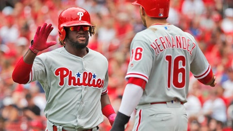 Philadelphia Phillies' Odubel Herrera, left, is congratulated by teammate Cesar Hernandez after hitting a two-run home run during the third inning of a baseball game against the St. Louis Cardinals, Saturday, May 19, 2018, in St. Louis. (AP Photo/Jeff Roberson)