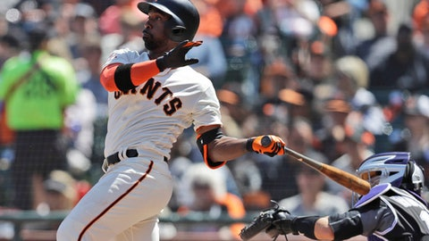 San Francisco Giants' Andrew McCutchen drives in two runs with a double against the Colorado Rockies during the fifth inning of a baseball game Saturday, May 19, 2018, in San Francisco. (AP Photo/Marcio Jose Sanchez)