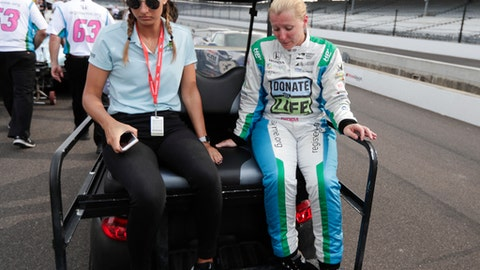 Pippa Mann, of England, rides out of the pit area after failing to make the field during qualifications for the IndyCar Indianapolis 500 auto race at Indianapolis Motor Speedway in Indianapolis, Saturday, May 19, 2018. (AP Photo/Michael Conroy)