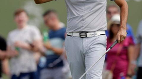 Kevin Na acknowledges applause from the gallery after his birdie putt on the 16th green during the third round of the AT&T Byron Nelson golf tournament, Saturday, May 19, 2018, in Dallas, Texas. (AP Photo/Eric Gay)