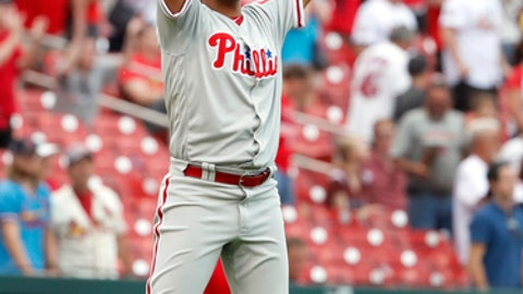 Philadelphia Phillies relief pitcher Seranthony Dominguez celebrates after getting St. Louis Cardinals' Matt Carpenter to fly out to end a baseball game, Saturday, May 19, 2018, in St. Louis. The Phillies won 7-6. (AP Photo/Jeff Roberson)