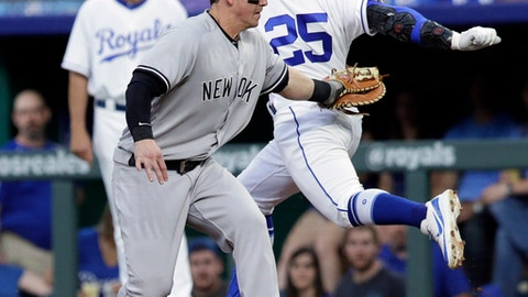 New York Yankees first baseman Tyler Austin, front, tags out Kansas City Royals' Jon Jay (25) during the first inning of a baseball game at Kauffman Stadium in Kansas City, Mo., Saturday, May 19, 2018. Jay grounded out to short. (AP Photo/Orlin Wagner)