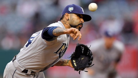 Tampa Bay Rays starting pitcher Sergio Romo throws to the plate during the first inning of a baseball game against the Los Angeles Angels, Saturday, May 19, 2018, in Anaheim, Calif. (AP Photo/Mark J. Terrill)