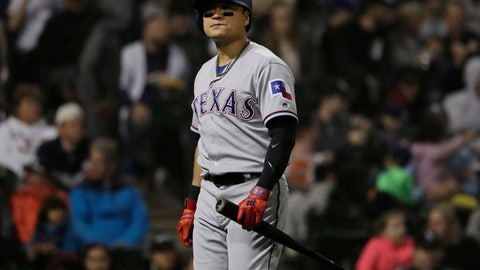 Texas Rangers' Shin-Soo Choo, of South Korea, reacts after striking out swinging during the seventh inning of a baseball game against the Chicago White Sox, Saturday, May 19, 2018, in Chicago. (AP Photo/Nam Y. Huh)