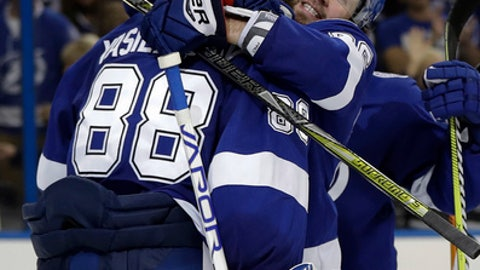 Tampa Bay Lightning right wing Nikita Kucherov hugs goaltender Andrei Vasilevskiy (88) after the Lightning defeated the Washington Capitals 3-2 during Game 5 of the NHL Eastern Conference finals hockey playoff series Saturday, May 19, 2018, in Tampa, Fla. (AP Photo/Chris O'Meara)
