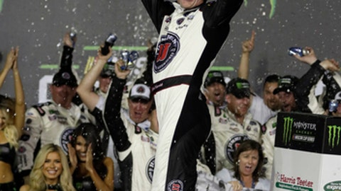 Kevin Harvick celebrates in Victory Lane after winning the NASCAR All-Star auto race at Charlotte Motor Speedway in Concord, N.C., Saturday, May 19, 2018. (AP Photo/Chuck Burton)