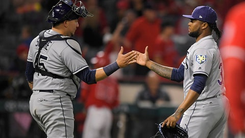 Tampa Bay Rays catcher Jesus Sucre, left, and relief pitcher Alex Colome congratulate each other after the Rays defeated the Los Angeles Angels 5-3 in a baseball game Saturday, May 19, 2018, in Anaheim, Calif. (AP Photo/Mark J. Terrill)