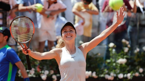 Ukraine's Elina Svitolina celebrates after defeating Romania's Simona Halep during their final match at the Italian Open tennis tournament in Rome, Sunday, May 20, 2018. Svitolina won 6-0, 6-4. (AP Photo/Gregorio Borgia)