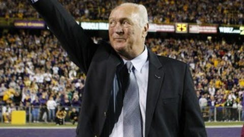 Former LSU running back and Heisman trophy winner Billy Cannon waves to the crowd at the end of the first quarter of the LSU-Tulane NCAA college football game  in Baton Rouge, La., Saturday, Oct. 31, 2009.  This is the 50th anniversary of Cannon's 89-yard  run against Mississippi.  (AP Photo/Bill Haber)