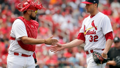 St. Louis Cardinals starting pitcher Jack Flaherty, right, is congratulated by catcher Francisco Pena as they walk off the field during the sixth inning of a baseball game against the Philadelphia Phillies, Sunday, May 20, 2018, in St. Louis. (AP Photo/Jeff Roberson)