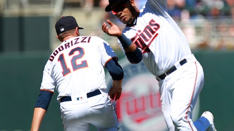 Minnesota Twins pitcher Jake Odorizzi (12) and Twins' shortstop Gregio Petit attempt to field a hit by the Milwaukee Brewers in the fifth inning of a baseball game Sunday, May 20, 2018 in Minneapolis. (AP Photo/Andy Clayton-King)