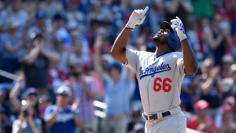 Los Angeles Dodgers' Yasiel Puig celebrates his two-run home run during the eighth inning of a baseball game against the Washington Nationals, Sunday, May 20, 2018, in Washington. (AP Photo/Nick Wass)