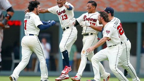 Atlanta Braves Dansby Swanson (7) reacts with teammates after hitting a winning two-run single in the ninth inning of a baseball game against the Miami Marlins, Sunday, May 20, 2018, in Atlanta. (AP Photo/Todd Kirkland)