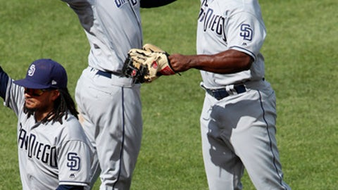 San Diego Padres' Jose Pirela, right, celebrates with Franchy Cordero after getting the final out of a 8-5 win over the Pittsburgh Pirates in a baseball game in Pittsburgh, Sunday, May 20, 2018. (AP Photo/Gene J. Puskar)