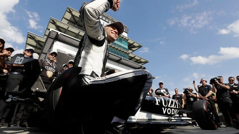 Ed Carpenter, foreground, celebrates after winning the pole for the IndyCar Indianapolis 500 auto race at Indianapolis Motor Speedway in Indianapolis, Sunday, May 20, 2018. (AP Photo/Darron Cummings)