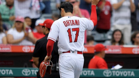 Los Angeles Angels starting pitcher Shohei Ohtani, of Japan, tips his cap to the crowd after being taken out of a baseball game in the eighth inning against the Tampa Bay Rays, Sunday, May 20, 2018, in Anaheim, Calif. (AP Photo/Mark J. Terrill)