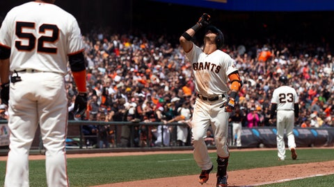San Francisco Giants Gorkys Hernandez, center, celebrates his two-run home run against the Colorado Rockies during the fifth inning of a baseball game, Sunday, May 20, 2018, in San Francisco. (AP Photo/D. Ross Cameron)