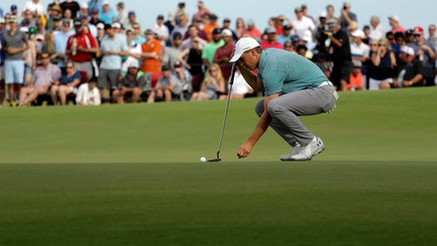 Jordan Spieth lines up his putt on the 18th green during the final round of the AT&T Byron Nelson golf tournament in Dallas, Sunday, May 20, 2018. (AP Photo/Eric Gay)