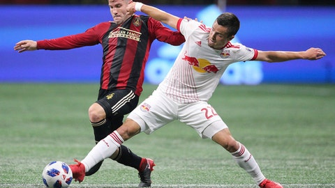 Atlanta United defender Greg Garza, left,  defends against New York Red Bulls midfielder Florian Valot, right, during the first half in a MLS soccer match Sunday, May 20, 2018, in Atlanta. (Curtis Compton/Atlanta Journal-Constitution via AP)