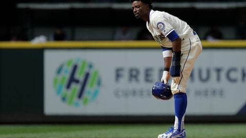 Seattle Mariners' Dee Gordon stands on second base after stealing in the 11th inning of a baseball game against the Detroit Tigers, Sunday, May 20, 2018, in Seattle. Gordon scored from second on a walk-off RBI single hit by Jean Segura and the Mariners won 3-2 in 11 innings. (AP Photo/Ted S. Warren)