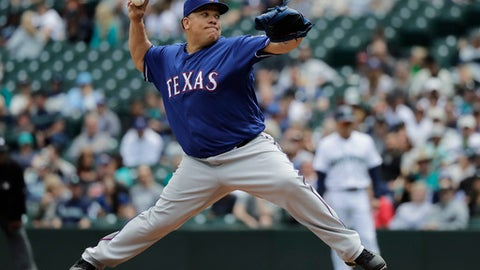 FILE - In this Wednesday, May 16, 2018, file photo, Texas Rangers starting pitcher Bartolo Colon throws to a Seattle Mariners batter during the third inning of a baseball game in Seattle. Just days before his 45th birthday, Bartolo Colon (2-1, 2.82 ERA) is scheduled to pitch Monday, May 21, 2018, for last-place Texas against the hard-hitting New York Yankees, who socked nine homers and totaled 18 runs in the final two games of their series at Kansas City. (AP Photo/Ted S. Warren, File)