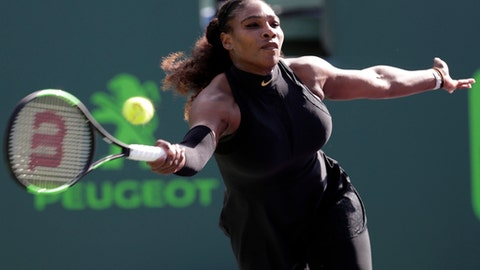 FILE - In this Wednesday, March 21, 2018 file photo, Serena Williams returns to Naomi Osaka, of Japan, during the Miami Open tennis tournament, in Key Biscayne, Fla. everal of Serena Williams' biggest rivals believe that the 23-time Grand Slam champion deserves more than just a guaranteed spot in the French Open draw. Williams, who is expected to play her first major since returning from maternity leave, should also receive a top seed that befits the No. 1 ranking she held when she left the tour, the players say. (AP Photo/Lynne Sladky, File)