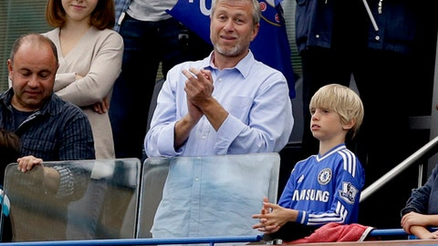 FILE - In this Sunday, May 24, 2015 file photo Chelsea's Russian billionaire owner Roman Abramovich, center, applauds after Chelsea were presented with the Premier League trophy after the English Premier League soccer match between Chelsea and Sunderland at Stamford Bridge stadium in London. (AP Photo/Matt Dunham)