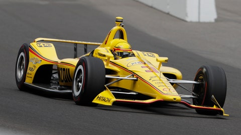 Helio Castroneves, of Brazil, heads into the first turn during a practice session for the IndyCar Indianapolis 500 auto race at Indianapolis Motor Speedway, in Indianapolis Monday, May 21, 2018. (AP Photo/Michael Conroy)