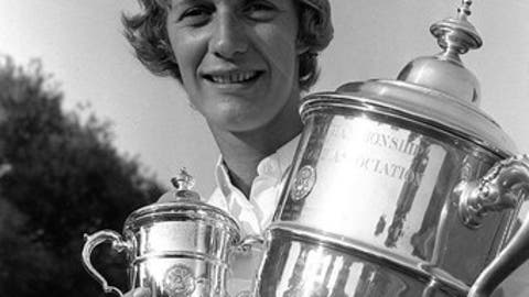 Carol Mann, of Towsen, Md., holds her trophies after winning the USGA Women's Open Golf Championship at the Atlantic City Country Club, Northfield, N.J., on July 4, 1965. Mann's final score was 290 for 72 holes.  (AP PHOTO)
