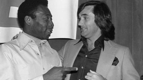 """FILE - In this April 7, 1978 file photo, Pele, left, and former Irish soccer star George Best, appear during an awards luncheon for Pele in Los Angeles. April 7, 1978. In Simon Doonan's book, """"Soccer Style: The Magic and Madness,"""" out June 12, Best is described as the glamour boy from Belfast. (AP Photo/George Brich, File)"""