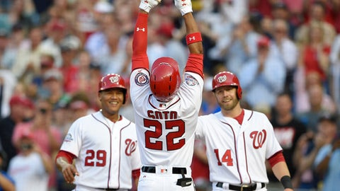 Washington Nationals' Juan Soto (22) celebrates his three-run home run with Pedro Severino (29) and Mark Reynolds (14) during the second inning of a baseball game against the San Diego Padres, Monday, May 21, 2018, in Washington. (AP Photo/Nick Wass)