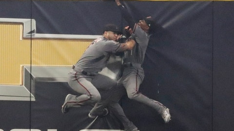 Arizona Diamondbacks' Jarrod Dyson and David Peralta catch a long fly ball hit by Milwaukee Brewers' Travis Shaw during the sixth inning of a baseball game Monday, May 21, 2018, in Milwaukee. (AP Photo/Morry Gash)