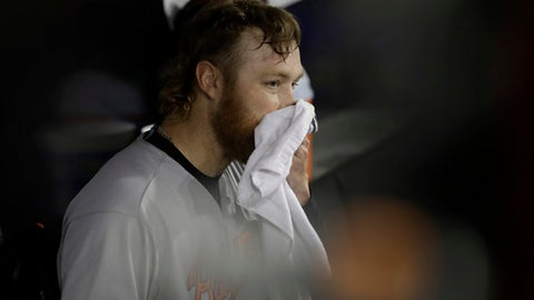 Baltimore Orioles starting pitcher Andrew Cashner sits in the dugout after being pulled from a baseball game against the Chicago White Sox during the sixth inning Monday, May 21, 2018, in Chicago. (AP Photo/Charles Rex Arbogast)