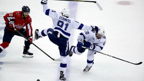 Washington Capitals center Lars Eller (20), from Denmark, watches as Tampa Bay Lightning center Steven Stamkos (91) and Tampa Bay Lightning center J.T. Miller (10) collide during the third period of Game 6 of the NHL Eastern Conference finals hockey playoff series, Monday, May 21, 2018, in Washington. The Capitals won 3-0. (AP Photo/Alex Brandon)