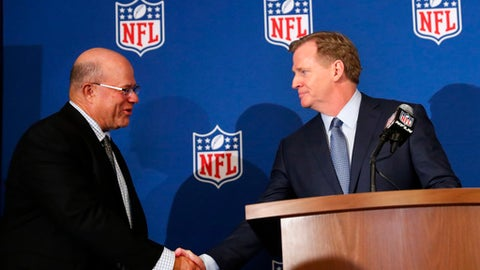 David Tepper, left, is greeted by as NFL commissioner Roger Goodall on during a news conference where he was introduced as the new owner of the Carolina Panthers at the NFL owners spring meeting Tuesday, May 22, 2018, in Atlanta. (AP Photo/John Bazemore)