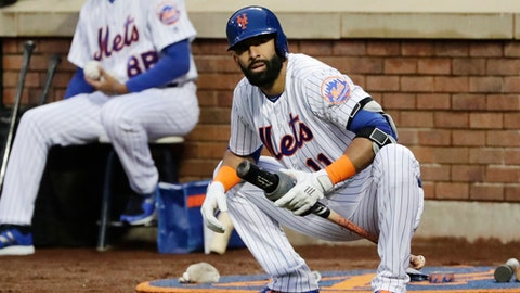 New York Mets' Jose Bautista (11) stretches while on deck during the first inning of a baseball game against the Miami Marlins Tuesday, May 22, 2018, in New York. (AP Photo/Frank Franklin II)
