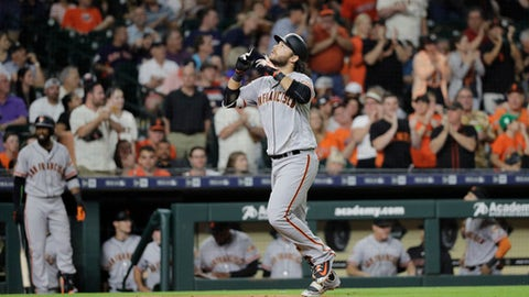 San Francisco Giants' Brandon Crawford reacts after hitting a two-run home run against the Houston Astros during the fifth inning of a baseball game Tuesday, May 22, 2018, in Houston. (AP Photo/David J. Phillip)