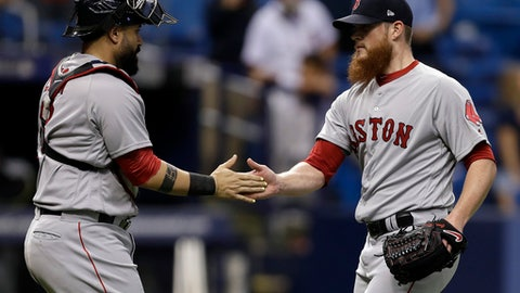 Boston Red Sox relief pitcher Craig Kimbrel, right, celebrates with catcher Sandy Leon after closing out the Tampa Bay Rays during the ninth inning of a baseball game Tuesday, May 22, 2018, in St. Petersburg, Fla. Boston won 4-2. (AP Photo/Chris O'Meara)