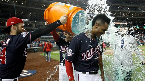 Washington Nationals' Michael Taylor is doused by Bryce Harper, left, and Trea Turner after his game-winning double in a game against the San Diego Padres at Nationals Park, Tuesday, May 22, 2018, in Washington. The Nationals won 2-1. (AP Photo/Alex Brandon)
