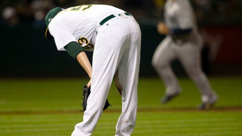Oakland Athletics starting pitcher Trevor Cahill (53) reacts to allowing a two-run home run to Seattle Mariners Mike Zunino during the seventh inning of a baseball game Tuesday, May 22, 2018, in Oakland, Calif. (AP Photo/D. Ross Cameron)
