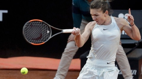 FILE - In this May 19, 2018, file photo, Romania's Simona Halep returns the ball to Russia's Maria Sharapova during their semifinal match at the Italian Open tennis tournament in Rome. Halep will be competing in the French Open tennis tournament that begins on Sunday, May 27.(AP Photo/Gregorio Borgia, File)