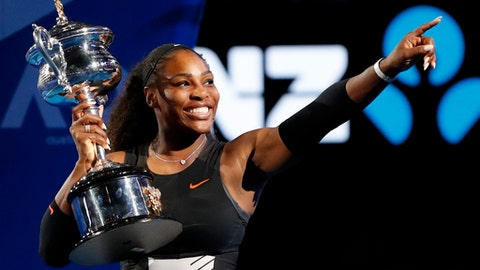FILE - In this Jan. 28, 2017, file photo, Serena Williams holds her trophy after defeating her sister Venus in the women's singles final at the Australian Open tennis championships in Melbourne, Australia. Main-draw action begins Sunday, May 27, 2018, in what would be Williams' first Grand Slam tournament in more than a year. (AP Photo/Dita Alangkara, File)