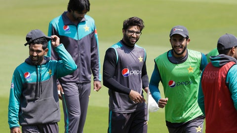 Pakistan's cricket team players laugh during a training session at Lord's cricket ground in London, Wednesday, May 23, 2018. England will play Pakistan in their first test match at Lord's starting Thursday. (AP Photo/Kirsty Wigglesworth)