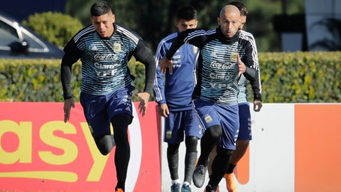 Javier Mascherano, right, and Marcos Rojo attend a training session with the Argentine national soccer squad in Buenos Aires, Argentina, Wednesday, May 23, 2018. Argentina will face Haiti on May 29 in an international friendly soccer match ahead of the FIFA Russia World Cup. (AP Photo/Victor R. Caivano)